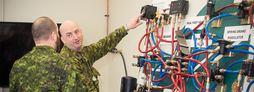 slide - Sergeant Robert Thomson from 33 Service Battalion demonstrates the operation of the airbrake system to Sergeant Andre Boisvert of 33 Combat Engineer Regiment during the Airbrake Course 16-20 February 2015 at Major Holland Armoury, Ottawa, Ontario.