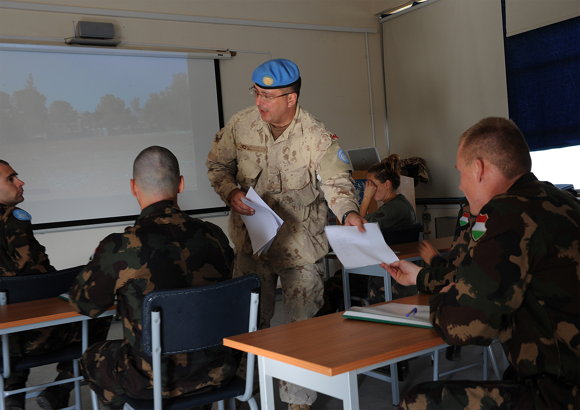 "Captain Michael Solonynko, Operation and Information Analyst Officer for the United Nations Headquarters in Cyprus, collects the answer sheets from Hungarian Soldiers after they have completed the ""Recognition and Observation"" stand for a Military Skills Competition being held at Blue Beret Camp in Nicosia, Cyprus on November 26, 2008.