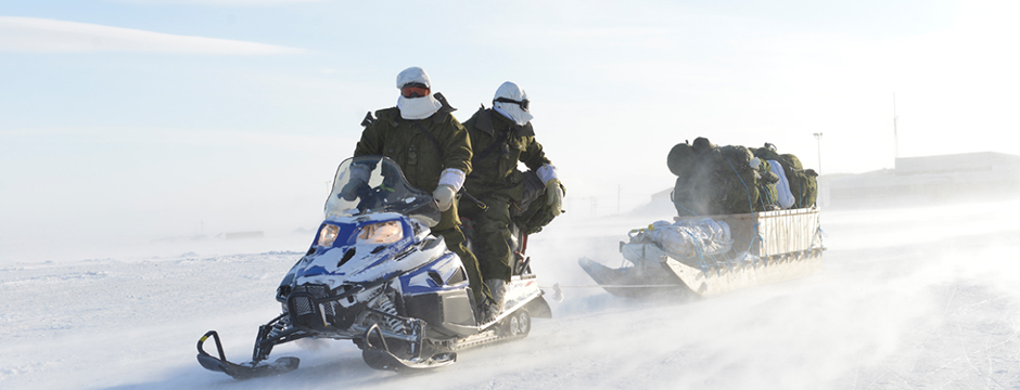 Slide - Soldiers on snowmobiles