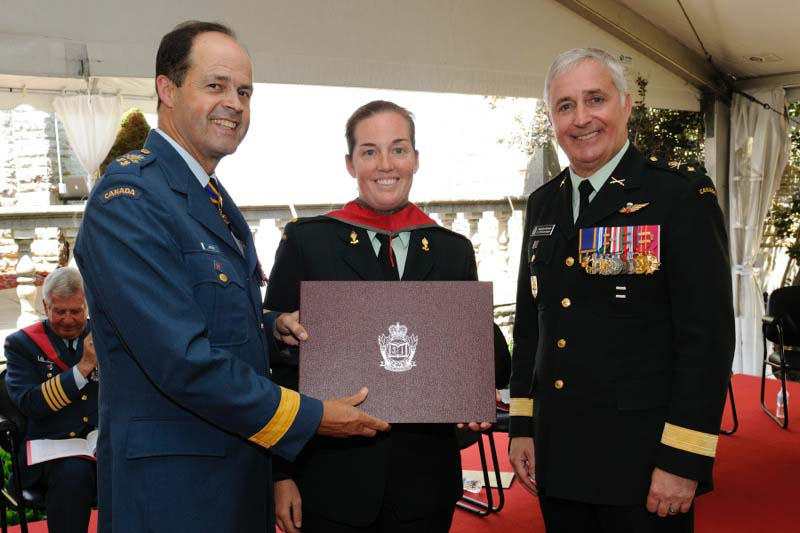 Major Sarah Heer receives her Joint Command and Staff Program Certificate from Chief of the Defence Staff General Tom Lawson and Brigadier-General Richard Giguere in 2014 at Canadian Forces College in Toronto, Ontario. Photo: provided by Lieutenant-Colonel Sarah Heer.