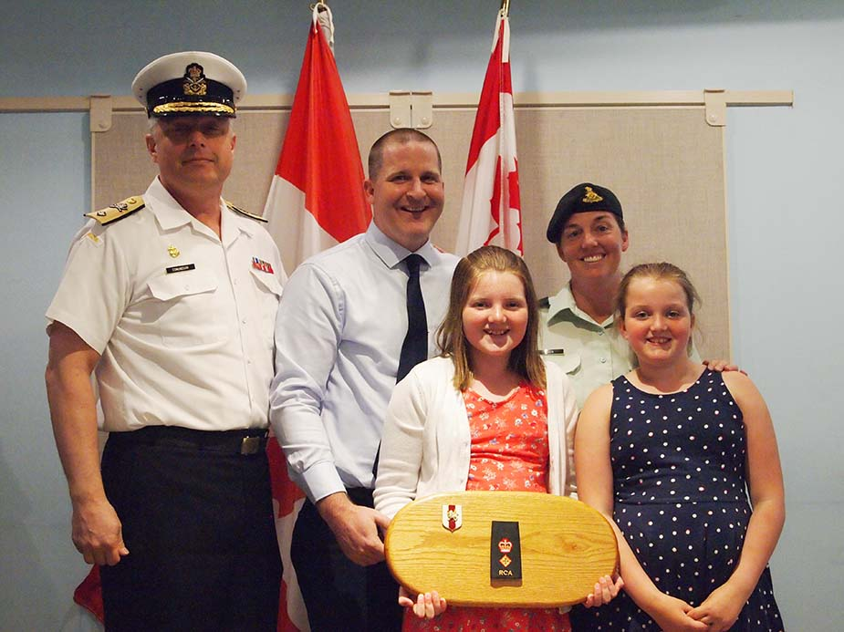 Lieutenant-Colonel Sarah Heer with Commodore Haydn Edmundson, her supportive husband James and children Jenna and Lauren, on the occasion of her promotion to her current rank in May 2016.