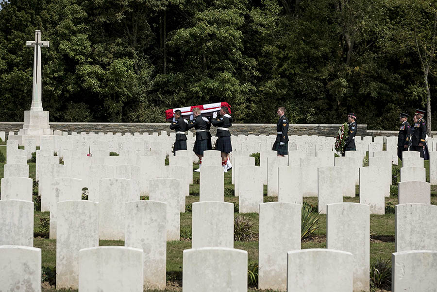 Representatives from the Government of Canada and the Canadian Armed Forces attend a military burial where an unknown Canadian soldier is laid to rest with military honours at Canadian Cemetery No. 2 in Neuville-St. Vaast, France on August 23, 2017. Photo: Corporal Andrew Wesley, Army Public Affairs. ©2017 DND/MDN Canada.