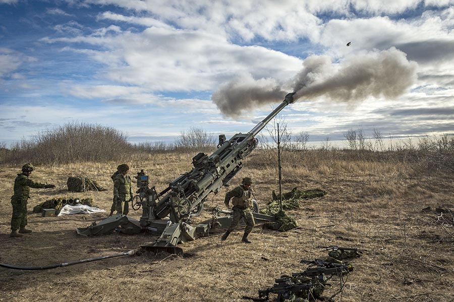 Members from 1st Regiment, Royal Canadian Horse Artillery, fire the M777 Howitzer during a fire mission on Exercise IRON RAM at 3 Canadian Division Support Base (3 CDSB) Garrison Wainwright's Training Area on October 24, 2017.