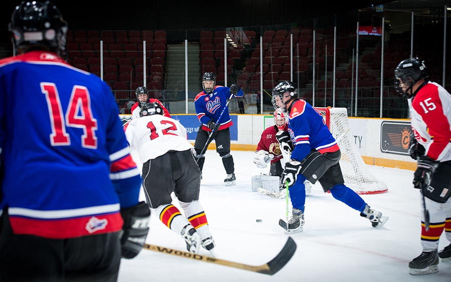 Members of the Princess Patricia's Canadian Light Infantry try to get the puck out of their defensive zone. Photo: Private Tori Lake, Canadian Forces Support Unit (Ottawa). ©2017 DND/MDN Canada.