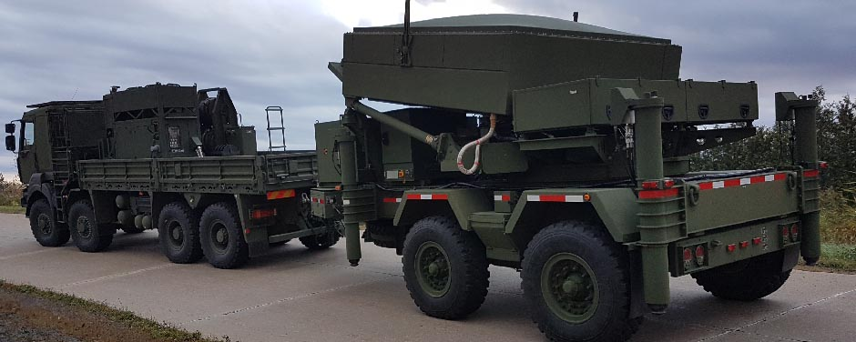 Slide - The collapsible Medium Range Radar system being transported
