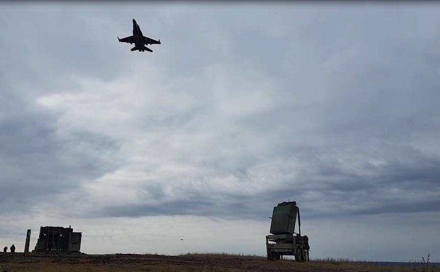 A CF-188 flies over the Canadian Army's new Medium Range Radar system in the fall of 2017 It can monitor air traffic in a combat area and locate sources of hostile indirect fire.