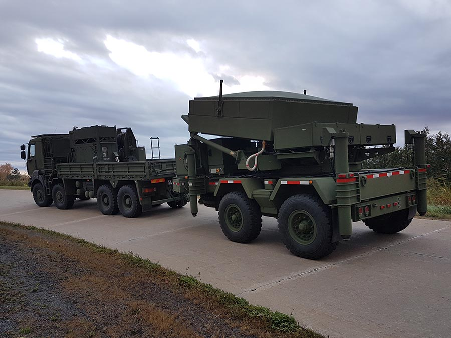 The collapsible Medium Range Radar system is transported by road on October 25, 2017 at 5th Canadian Division Support Base Gagetown using a specially-equipped vehicle (following view).
