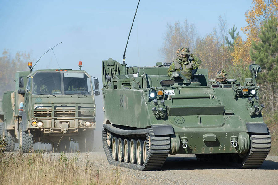 Soldiers from 4th Artillery Regiment (General Support) participate in a convoy road move during Exercise TURBULENT WINDS in October 2017. Following a recent Transfer of Command Authority, the unit now reports to the Canadian Combat Support Brigade Headquarters.