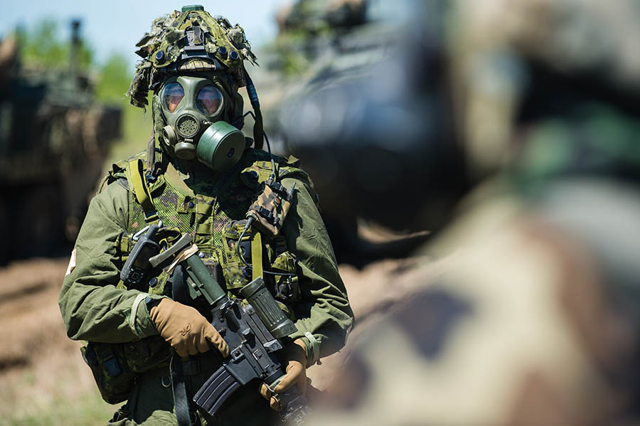 A Canadian soldier participates in a decontamination drill after a simulated chemical attack during Exercise MAPLE RESOLVE 2018 in Wainwright, Alberta on May 19, 2018.