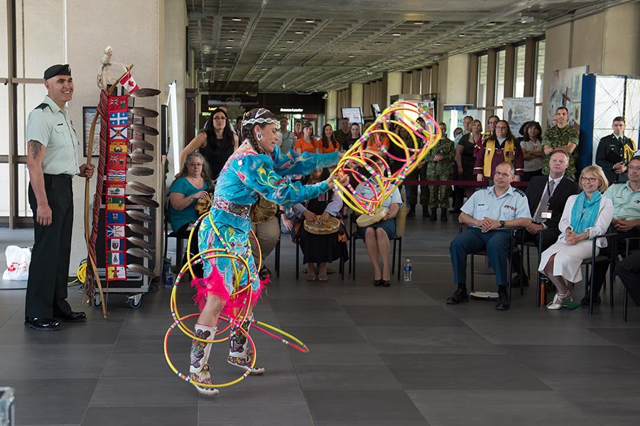 Ms. Célina Cada-Matasawagon performs a traditional hoop dance during the Aboriginal Awareness Week event held at National Defence Headquarters in Ottawa, Ontario, on 26 May, 2016. Photo: Corporal Chase Miller Canadian Forces Support Unit (Ottawa) - Imaging Services ©2016 DND/MDN, Canada.
