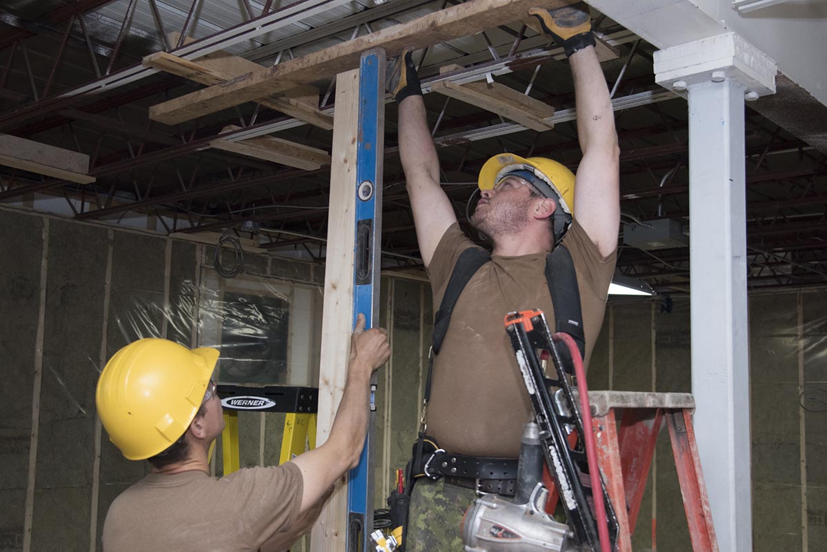 Construction Technicians from 4 Engineer Support Regiment's 45 Vertical Construction Squadron make renovations to the Boys and Girls Club of Summerside during Exercise NIHILO SAPPER 2018 which took place in locations throughout Prince Edward Island from November 1 to 20, 2018. Photo: ©2018 DND/MDN Canada.