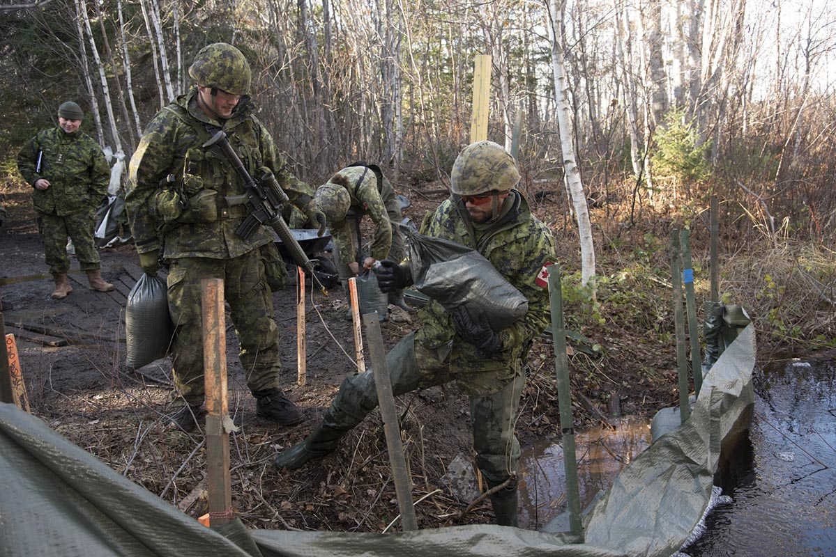 Combat Engineers from 4 Engineer Support Regiment's 42 Horizontal Construction Squadron builds a non-standard bridge on the Lennox Island First Nation trail system during Exercise NIHILO SAPPER 2018 which took place in location throughout Prince Edward Island from November 1 to 20, 2018. Photo: ©2018 DND/MDN Canada.