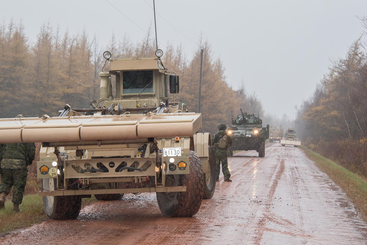 Combat Engineers from 4 Engineer Support Regiment's 43 Counter-Improvised Explosive Device Squadron use expedient route opening capability vehicles to conduct explosive threat searches along transport routes during Exercise NIHILO SAPPER 2018 which took place in locations throughout Prince Edward Island from November 1 to 20, 2018. Photo: Corporal Brett White-Finkle, 14 Wing Imaging. ©2018 DND/MDN Canada.