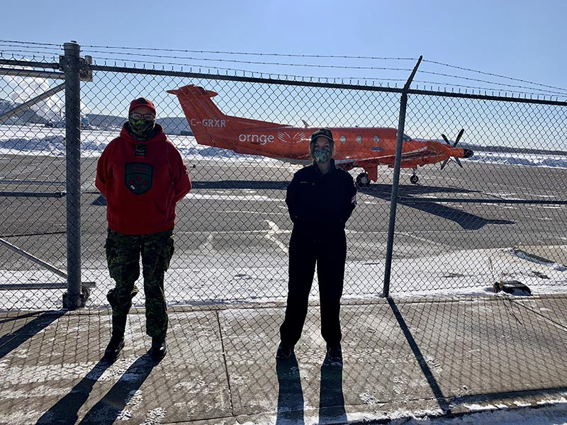 Members of 3 Canadian Ranger Patrol Group seen outside of Ornge Thunder Bay Base on February 12, 2021. Ornge is Ontario's air ambulance and critical care transport services, which is distributing COVID-19 vaccines with the help of Rangers and Reservists from the Canadian Army and Royal Canadian Navy. Photo: provided by HMCS Griffon. ©2021 DND/MDN Canada.